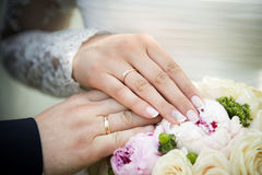 Hand on the wedding bouquet Stock Photos