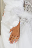 Hand on wedding gown Stock Image