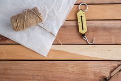 Hand weights, string and wrapping paper on natural wooden background. stock photos