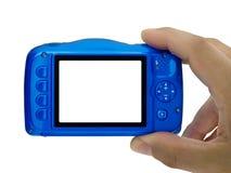 Hand, welche Bildkompaktkamera die leere Anzeige lokalisiert nimmt lizenzfreie stockfotos
