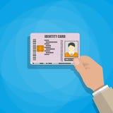 Hand, welche die Identifikations-Karte hält Stockfoto