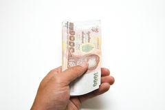 Hand were holding money. On white background Stock Images