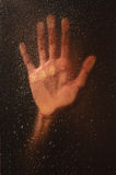 Hand on a wet window with raindrops. loneliness concept Stock Photography