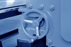 Hand wheel in a production line Stock Photography