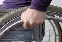 Hand on wheel of wheelchair close-up Royalty Free Stock Photography