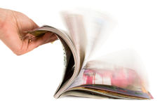 Hand which is thumbing magazine Stock Photos