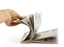 Hand which is thumbing magazine Royalty Free Stock Image