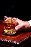 Hand with Whiskey Glass and Cigar Stock Photos