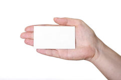 Hand with white card. On a white background Stock Photography