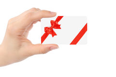 Hand with white card and red bow Royalty Free Stock Photo