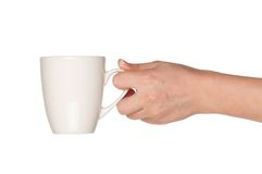Hand with white cup Royalty Free Stock Images