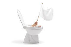 Hand with white flag coming out from toilet bowl Stock Images