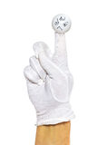 Hand in white glove and angry finger puppet Royalty Free Stock Image