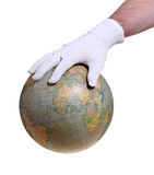 Hand with white glove holding globe. Hand with glove holding globe on white stock photography