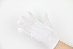 Hand in white glove Royalty Free Stock Photos