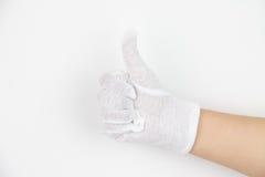 Hand in white glove Stock Photos
