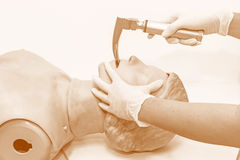 Hand and white medical gloves of doctor demonstration resuscitat Stock Photography