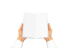 Hand in white shirt sleeve holding blank brochure booklet in the Stock Photography