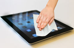 Hand with white wet wipe tablet cleaning Stock Photo