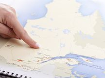 Hand who pointing Quebec on a MAP Royalty Free Stock Image
