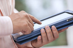 Hand wih digital tablet. The digital tablet in a hand chooses function Stock Images