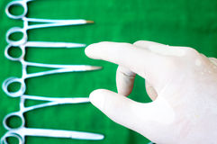 Hand will take surgical instruments Royalty Free Stock Image