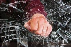 Hand Through Window. Hand through broken glass window Stock Photo