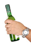 Hand with wine bottle Stock Photography