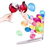 Hand with wine and laptop Stock Photo