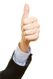 Hand of a winner holding thumbs up Stock Images