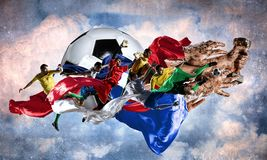 We did it. Hand of winner tighten the cup against blue sky background Stock Photo