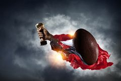 We did it. Hand of winner tighten the cup against sky background Royalty Free Stock Images
