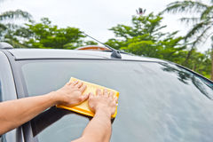 Hand wipe cleaning car glass Royalty Free Stock Photography
