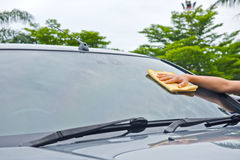 Hand wipe cleaning car glass Stock Images