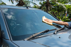 Hand wipe cleaning car glass Royalty Free Stock Photos
