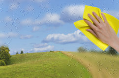 Hand wiping off rainy window Royalty Free Stock Images