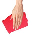 Hand wiping surface with red rag isolated on white Royalty Free Stock Photography