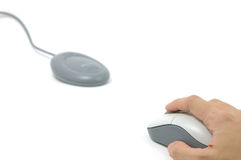 Hand on wireless mouse and receiver. In isolated white background stock image