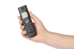 Hand with wireless radio telephone Royalty Free Stock Photos