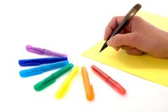 Hand_wit_pens Stock Images