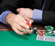 Hand With Casino Chip Stock Images