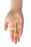 Hand With Golden Key Royalty Free Stock Image