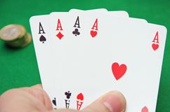 Hand With Poker Of Aces On A Green Table Game Royalty Free Stock Images