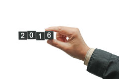Hand withblack number square dice 2016. Hand with black number square dice. Happy new year. Business man holding 2016 new year Royalty Free Stock Photos