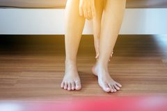 Hand woman with ankle injury,Massage pain,Female hurting and holding painful sprained ankle. Close up Royalty Free Stock Photo