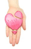 Hand of woman with broken heart shaped salt dough Royalty Free Stock Photos