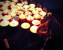 hand of woman and candles with old toned effect