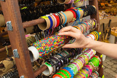 Hand of woman with colorful bracelets on stall at the bazaar Stock Photo