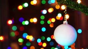 Hand woman decorating on Christmas tree with Christmas glow lights. stock footage