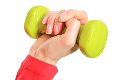 Hand of woman during fitness exercise with dumbbells Royalty Free Stock Image